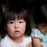 Tokyo / Saitama - One of the children at the evacuation centre.