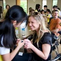 Nara - Sarah exchanging business cards with young choir member.