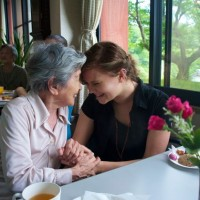 Takarazuka - Hannah chats with nursing home resident after performance.
