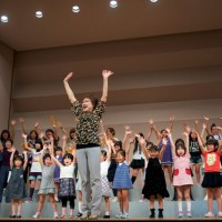 Fukuoka - Local choir leader Miyoko dances as she conducts and joins in for the big leap finish.
