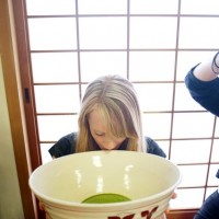 Grace drinking very green tea from a very large teacup.