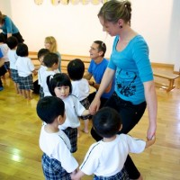 Fukuoka - Sarah dancing with kids at the kindergarten.