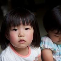 Tokyo / Saitama - One of the children at the evacuation centre.