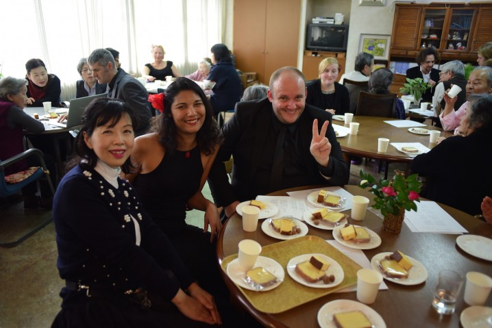Darya and Jesse enjoying tea with the residents of Miki nursing home.